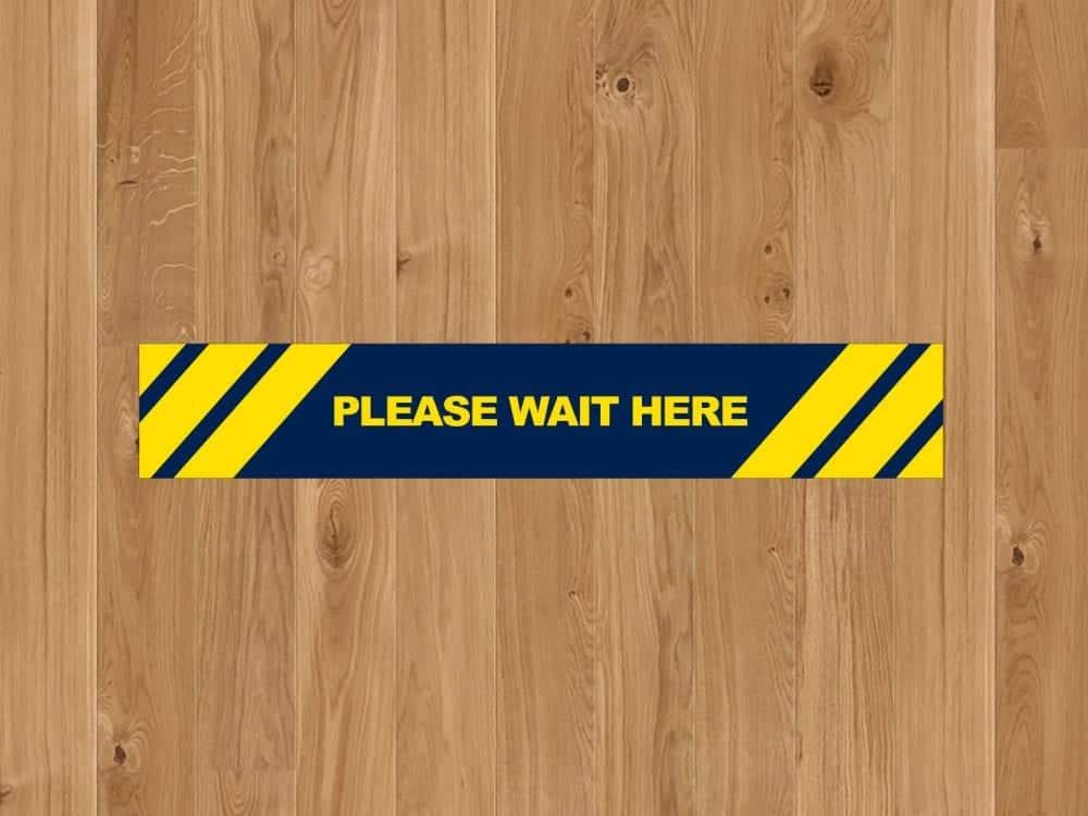 Social Distancing Floor Strip on a laminate floor
