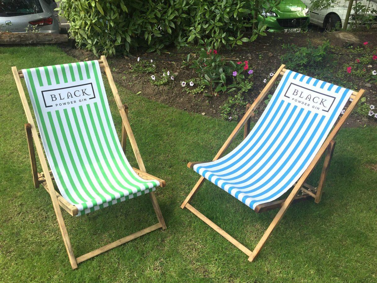Pair of printed deckchairs