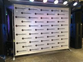 A step and repeat banner stand